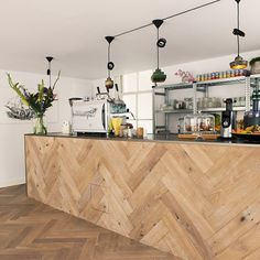 The marketing specialists have been on a barista course to bone up on the bean grinding, using a mezzanine level of their business premises to house a serving counter clad in the same chunky wooden herringbone as the floor, with the remainder of the public area devoted to relaxed café lounge seating... #cafe #coffee