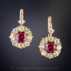 A pair of richly saturated deep red round faceted rubies, totaling 1.41 carats, radiate from within sparkling halos of bright white old mine-cut diamonds (plus a single twinkler on top) in these classic late-Victorian/Edwardian-era earrings rendered in rich 18K rosy-yellow gold - circa 1900. 1.00 carat total diamond weight, 5/8 inch, most likely of British origin.