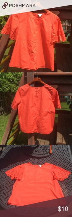 J. Crew Orange Cut Out Shirt!! This flowy orange shirt is a small from J. Crew. Has beautiful cut out sleeves and buttons up on the back. Has only been worn once or twice and has no defects. J. Crew Tops Blouses