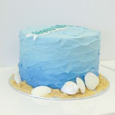 Blue ombre wave textured buttercream cake with edible sand and sea shells by Les Amis Bake Shoppe / Baton Rouge, LA