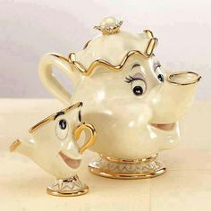 Photo: It's Tea Time! Among the most memorable tea cups and tea pots in any movie, don't you think? :)Among the most memorable tea cups and tea pots in any movie, don't you think? Deco Disney, Disney Belle, Walt Disney, Disney Princess, Disney Figurines, Collectible Figurines, Cute Kitchen, Teapots And Cups, Chocolate Pots