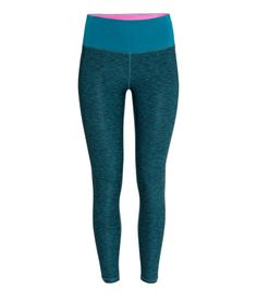 Teal melange workout leggings in fast-drying fabric with neon pink lining. | H&M Sport