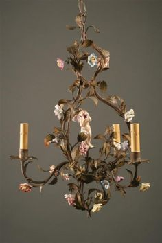 Antique Italian three arm iron and porcelain chandelier with cupid. #antique #chandelier #iron