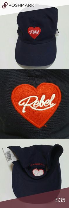 Brandy Melville Rebel Hat Lovely Brandy Melville Kathleen Baseball cap Hat that is navy dark blue with a red and white heart  rebel patch sewn on the front and the back has J Galt 44 Prince St. NY sewn in red on the back. athis is brand new with tags! Unused Unworn and in perfect condition. Great with your favorite shirt and jeans. Other great Brandy Melville listed in my closet. Brandy Melville Accessories Hats