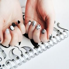 Easier than it looks, a monochrome print nail art tutorial - get the latest trend on your nails!