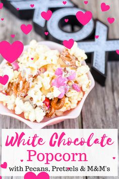 White Chocolate Covered Popcorn with Pecans, Pretzels and M&M's is sweet, salty, crunchy and delicious. This popcorn is easy to make and fun to eat. It's the perfect treat for Valentine's Day!