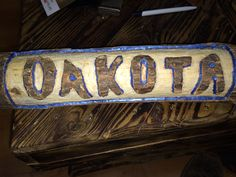 Sign made for a relative. Carved from a firewood log.