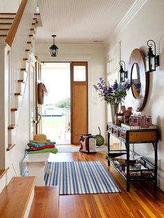 With a Console.  If there was one piece of furniture that is destined for the foyer it's the console table. Defined by its long and narrow shape, a console table squeezes into narrower spaces and is perfect for an entry because of its design. Pair it with a statement mirror or work of art, then add a bouquet of seasonal blooms to make your foyer welcoming.