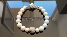 US26.00 Round pearl bracelet Pastel #blue pearl White cultured pearl Simple #swarovski #pearl #jewelry Pave bead bracelet Daily bracelet Winter bracelet Christmas bangle Xmas bracelet Best holiday gift Present from parents Ideal gift for her Xmas gift idea  Round pearl winter #bracelet looks so gently and pretty!  This #Christmas bangle could be the best #holiday gifts! It is a great #Xmas gift idea, lovely present for daughter from parents or ideal #gift for her! #birthday #marriage #bride