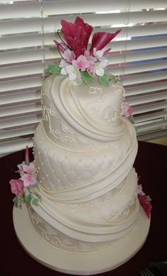 quilted wedding cake with flowers | Wedding cake with fondant drape, edible pearls and gum-paste flowers.
