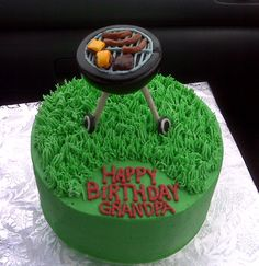 Weber Grill Cake. Buttercream cake and grass, with marshmallow fondant decorations prepared days in advance so they were hard enough. :) (also used wooden skewers covered in fondant for the grill's legs.)