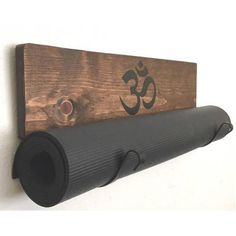 The Original yoga mat display made by YogaWares, first to market, handmade solid wood and customizable
