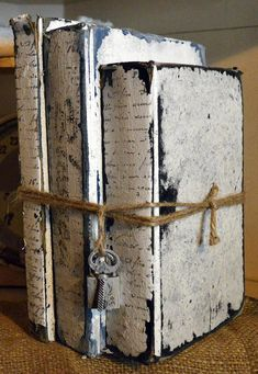 A Bundle of 3 Painted Vintage Books - Shabby-Chic Bound with String, Ive added a padlock and Key The Stack has been painted White and Distressed, Front cover is textured painted white and distressed The books can be seperated to display single, or rearranged in the Stack Pair with other Book Stacks or use alone Beautifully Adorned to enhance any Decor (or Event) A Beautiful Display 2nd Set Ships Free! Perfect Gift for any Occasion Would be a wonderful Centerpiece for Weddings, Showers...