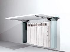 Mesa Abatible Cubre-Radiador optimiza espacio ocupado por radiador creando una mesa abatible. Fabricado con Escuadra Abatible Multitarea M7 de Joster.