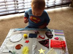 A fun, textured surprise board you can mak for your baby to explore!