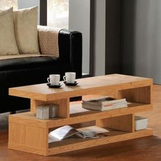 Interesting (but useful) design for a COFFEE TABLE - 120 x 39 x 36cm