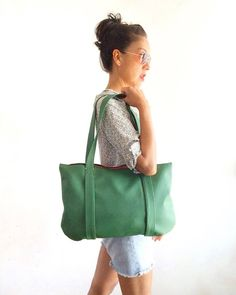 A forest green vegan bag with a seventies nostalgia-attitude captures the downtown-cool style. Featuring a metal zip closure, two comfy shoulder straps, a roomy interior with two inner pockets, this shoulder bag makes the perfect everyday companion for your fall winter outfit. A big plus is the lining! Dimentions 11x17in (28x43.5cm), handles 25.5in (63cm). Its ready to ship worldwide. Label: Pitti Vintage Handmade in Italy Material: Vegan Leather 100% polyurethane (durable, soft and easy to…