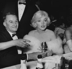 Marilyn with her agent Rupert Allen at the Golden Globe Awards, 8 March 1960.