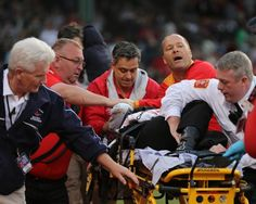 A fan was removed on a stretcher after being struck by the sharp edge of a broken bat.