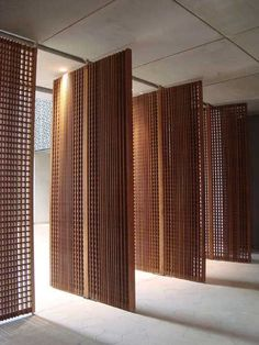 Decorative timber architectural Screens. Functional yet aesthetically pleasing. Would work well as a divider of the indoors from the outdoors, or a decorative feature wall on the inside. the small holes in the screens make for wonderful warm lighting. More