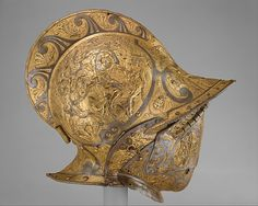 Burgonet with Falling Buffe. The medallions on either side of the bowl are embossed with scenes from Greek mythology depicting the Battle of Centaurs and Lapiths, a popular subject in Renaissance art. Joseph Pulitzer, Ancient Armor, Medieval Armor, Medieval Helmets, Good Knight, Armadura Medieval, Knight Armor, Arm Armor, Fantasy Inspiration