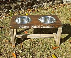 """RECYCLED PALLETS: Give your dog their very own Farmhouse Table! It has been painted and stained to match the Human's Farmhouse Table. Measurements: 24"""" long by 12"""" deep and 12"""" high Cost: $45 Rustic painted and stained$50 for full paint coverage. $38 natural/""""naked"""" and comes with 2 60 oz. Stainless Steel bowls!  Message us if you are interested in ordering one of these.    ITEM# 1,541"""