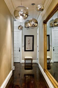 entrances/foyers - Tom Dixon Mirror Ball, foyer hall, foyer hallway, long hall, long hallway, foyer lighting, foyer pendants, gold mirror, b...