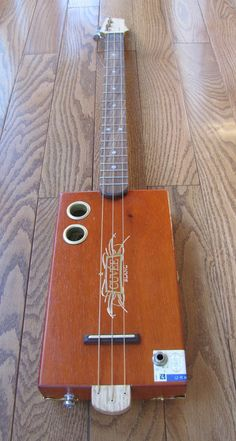 Another one of my dads Cigar Box Guitar  3 String Cuvee Blanc by BarefootBoogieGuitar, $285.00