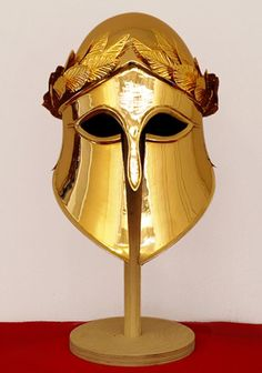 An interesting attempt to recreate what the Corinthian helmets worn by Leonidas' bodyguards, the brothers Alfeos [Alpheos] and Maron, may have looked like. Traditionally they are held by some to have been Olympic champions, and so in place of a horsehair crest, the helmet is decorated with a representation of an Olympic champion's wreath of victory.