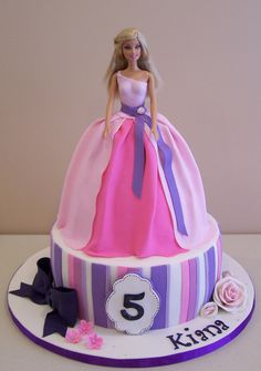 "This weekend was a Barbie weekend! I made two Barbie cakes for two beautiful little girls. This was one of them. I was given the colours (pink and purple) and free reign on design...a lot of fun!! 10"" cake"