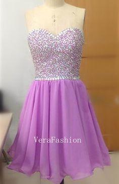 I love the color purple, looks good on a dress (: