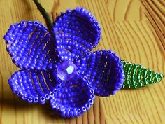 Victorian Beaded Flower Tutorial            Materials:     Size 10/0 seed beads  1 x 6mm bead  28 gauge wire  Green floral tape...