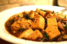 This spicy garlic tofu is similar to ma po tofu, a popular Sichuan dish. Pretty much anything coming out of Sichuan will be spicy, but this version is a bit milder than the
