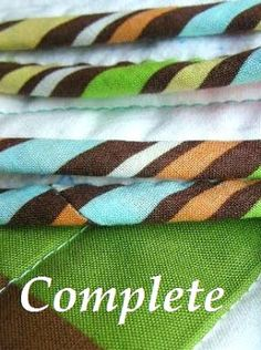 Tutorial on binding quilt, from making the binding to sewing it, to making mitred corners