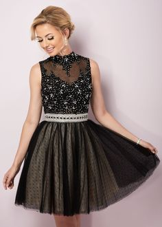 When you have a dress that features glitter, lace, jewels, and illusion, you have a recipe for style.  You'll dazzle in this sparkling elegant party dress from Hannah S. Style 27095 has a trendy lace high neckline that leads to a jeweled illusion and lace bodice.  This short cocktail dress is completed with a lovely jeweled belt and gathered swiss dot net s-line skirt.