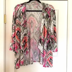 Patterned cardigan Very bright! It's white with pink, green, peach, and orange. It's open in the front and the sides cascade down. The sleeves are about 3/4 length. 96% polyester and 4% spandex. Chico's size 3 which is 16/18. Chico's Sweaters Cardigans