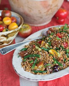 Hearty farro stands in for more traditional orzo or rice in this colorful, flavor-packed salad.