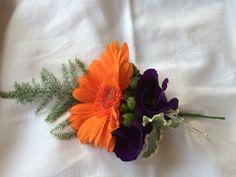 Orange gerbera with purple lissianthus buttonhole