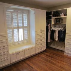 Nice built-ins with bench. Makes having a window in the closet look good.
