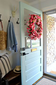 How to Make a Tulip Wreath for the Front Door - An easy tutorial on how to make a pretty tulip wreath for your front door for spring. #diyproject #wreath #spring