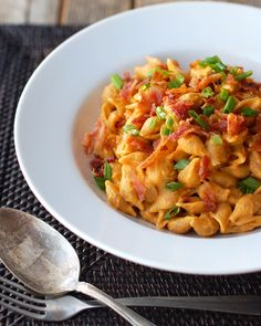 You can practically smell fall weather from this Healthy Bacon & Pumpkin Pasta recipe.
