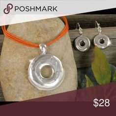 """Arriving Soon designer silver pendant orange cord. Designer-style 1 5/8"""" polished silvertone ring pendant on an 18"""" adjustable orange triple cord necklace with matching pierced wire earrings. Jewelry Necklaces"""