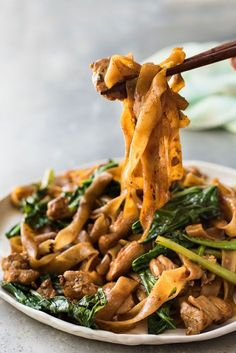 An easy, authentic recipe for Pad See Ew, one of the most popular stir fried Thai noodles with chicken.