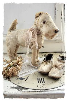 ***Don't throw away that ratty old dog. It's obvious somebody loved him very much. Look how he stands! He's not done yet!