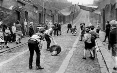 Although many today would rather play football, for a long time cricket was one of the most popular sports among children. Here, a group of children play a match in the Scotswood area of Newcastle in 1970.