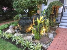 Acorn Ponds & Waterfalls brought this Rochester (NY) front yard landscape to life with the installation of this stunning custom designed water feature with fire… Backyard Water Feature, Ponds Backyard, Backyard Ideas, Pond Maintenance, Pond Waterfall, Asian Garden, Home Garden Design, Garden Fountains, Outdoor Fountains