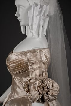 This wedding dress was worn by Martha Webster (1820–1894), who married widower Henry Lewis Miller (1806–1861) of Hartford in 1838.