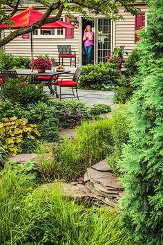 A lush rain garden in a small suburban Chicago backyard saves water, reduces pollution and provides a lot of fun! Sloped Backyard, Backyard Patio, Backyard Ideas, Rain Garden, Forest Garden, Garden Bed, Water Garden, Herb Garden, Garden Plants