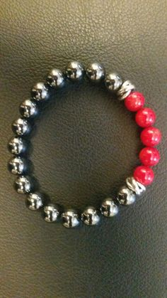 Pickett Art. Red Bamboo Coral, Sterling Silver Knots, Hematite Beads.