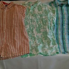 Bundle of three MEN'S camp shirts short sleeves Three shirts, but just one price! Also just one shipping price! All shirts by Aigle, have one pocket, and chest measures 26 inches across laying flat on all three. Red plaid is 100% cotton. Hawaiian print is 100% linen. Green and blue plaid is 92% cotton 8% nylon. All excellent condition. Wrinkled from storage. Aigle  Tops